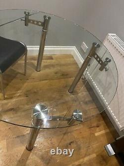 Extendable Round Or Rectangular glass dining table and 4 black chairs