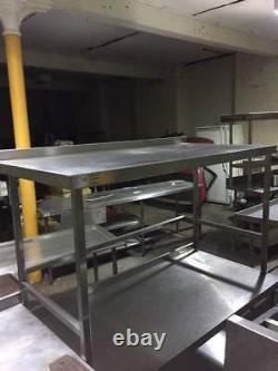 Stainless steel table/work bench with upstand on back